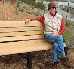 Bill Best sitting on bench