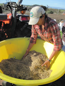Mary Paul, Restoration Specialist, prepares native seed for broadcast seeding